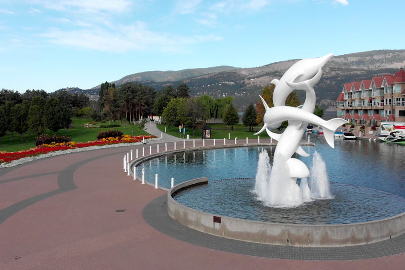 view of a fountain with a dolphin statue