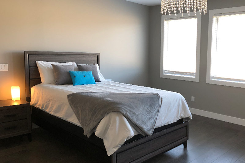 View of a bedroom with a bed and nightstand on the left